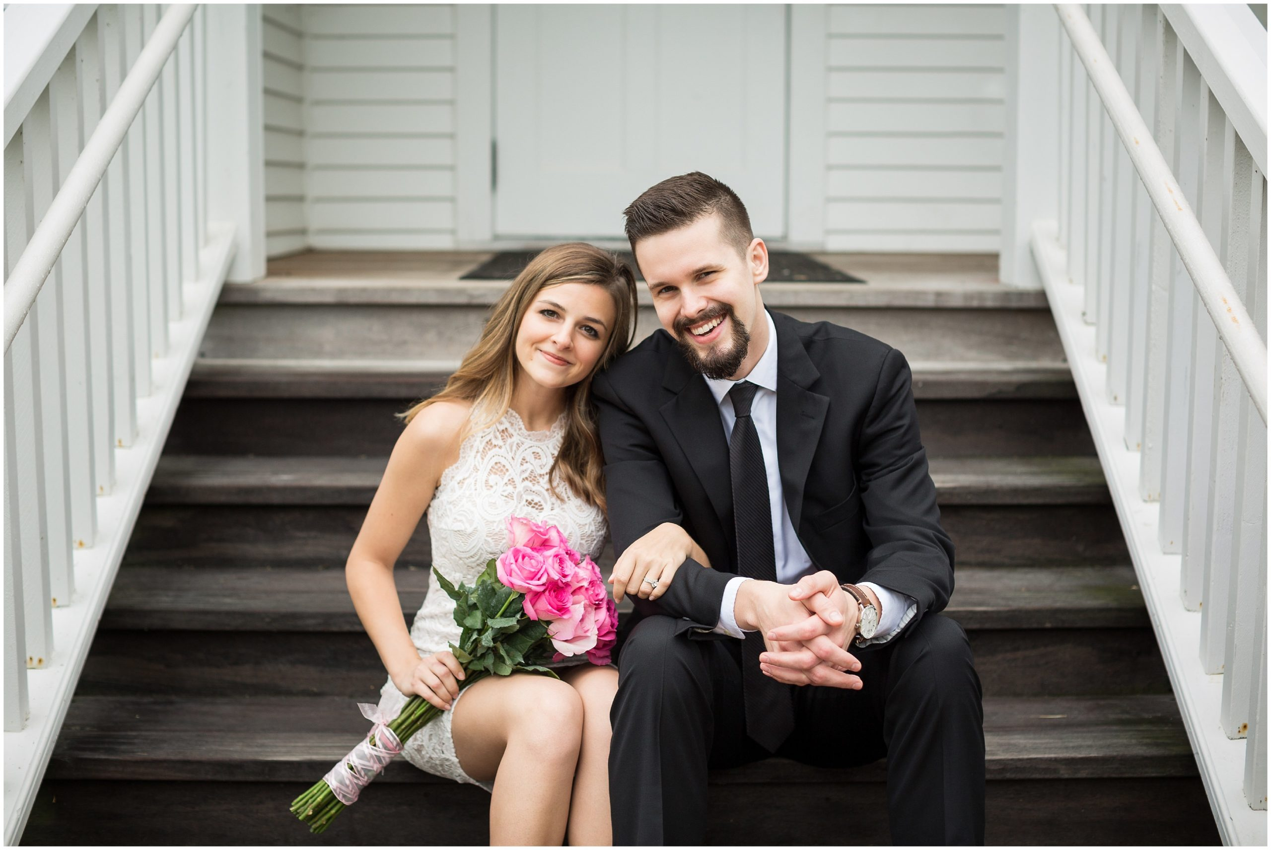 Couple sitting on stairs and smiling