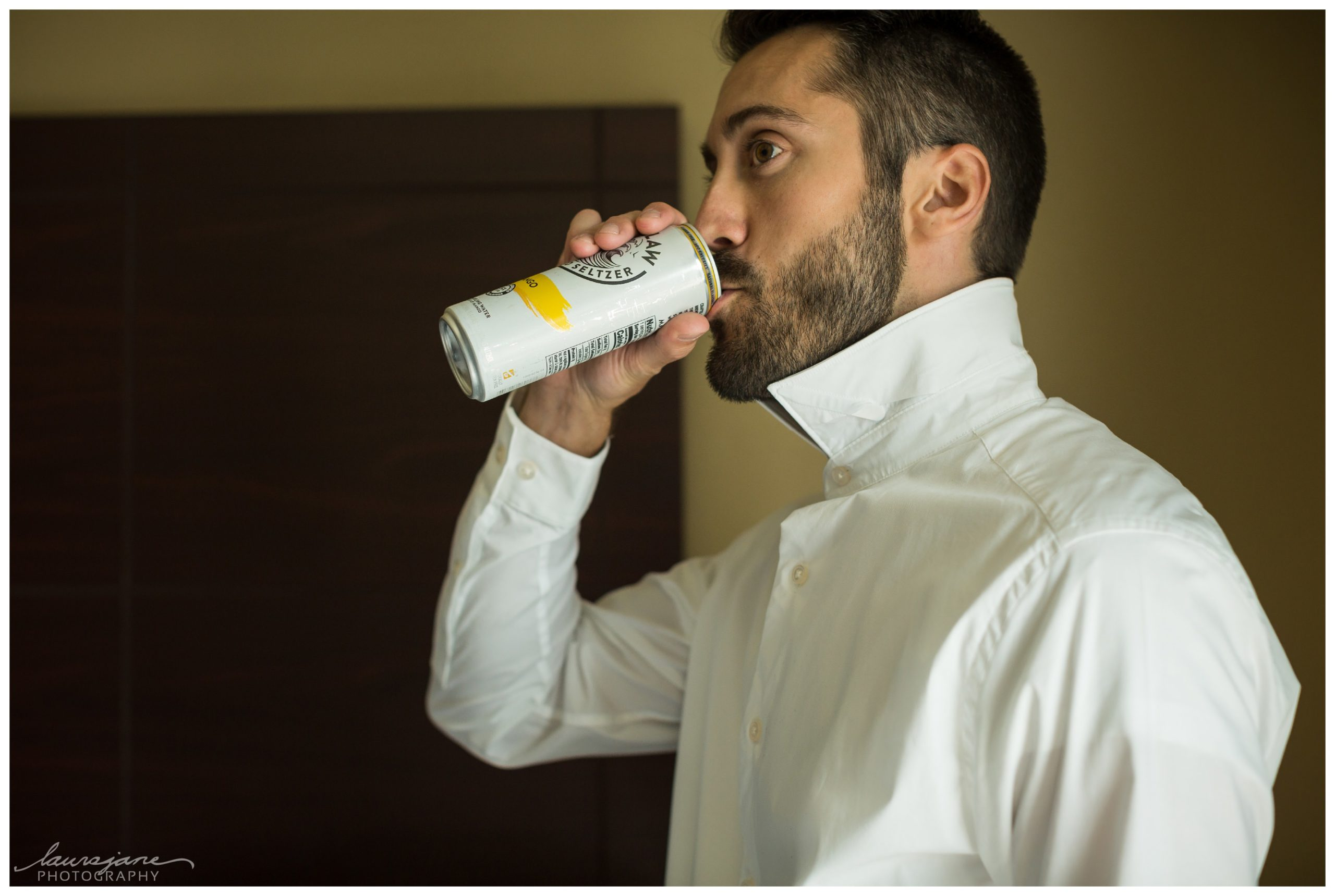 Groom Drinking a WhiteClaw