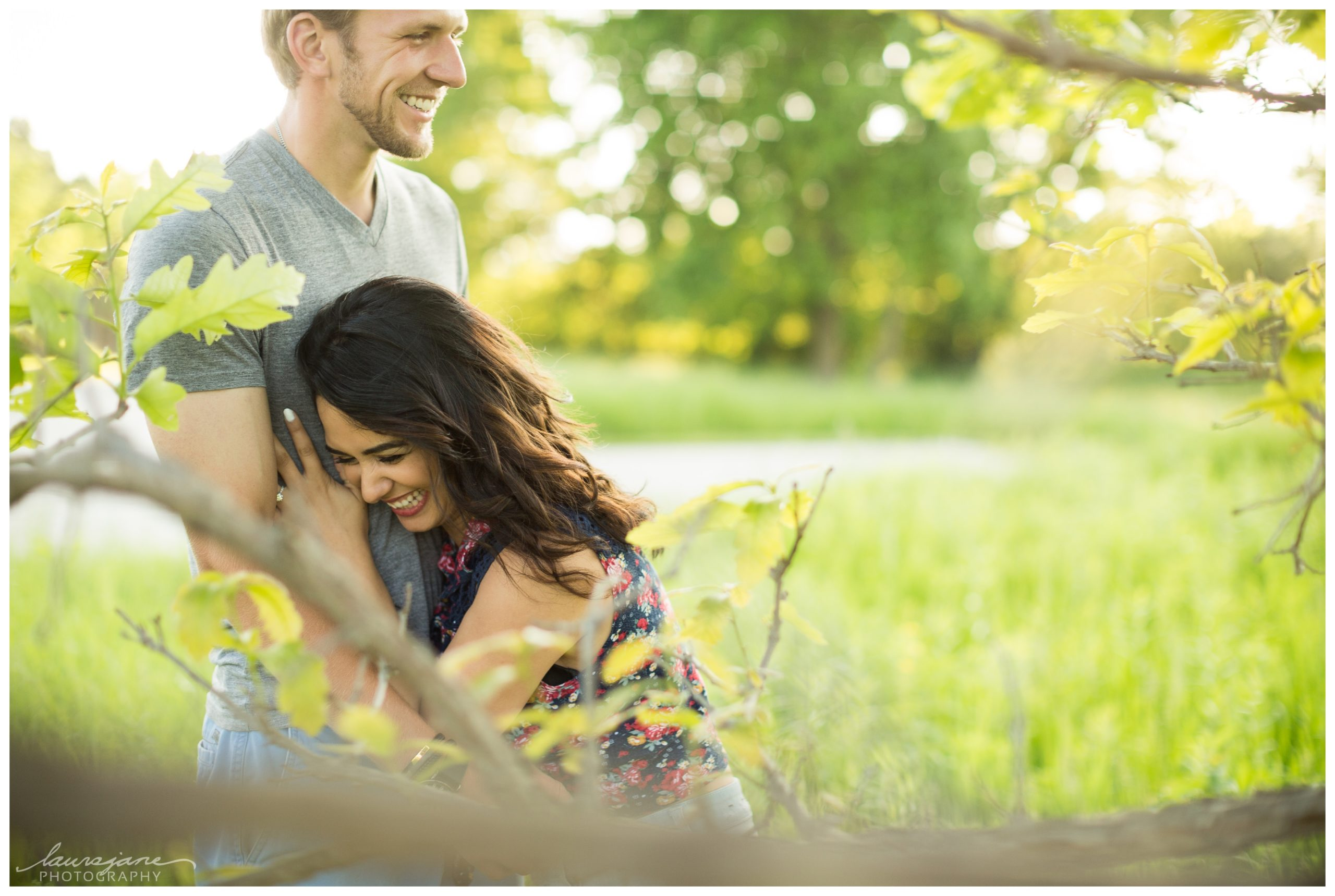 Couple laughing really hard during engagement session