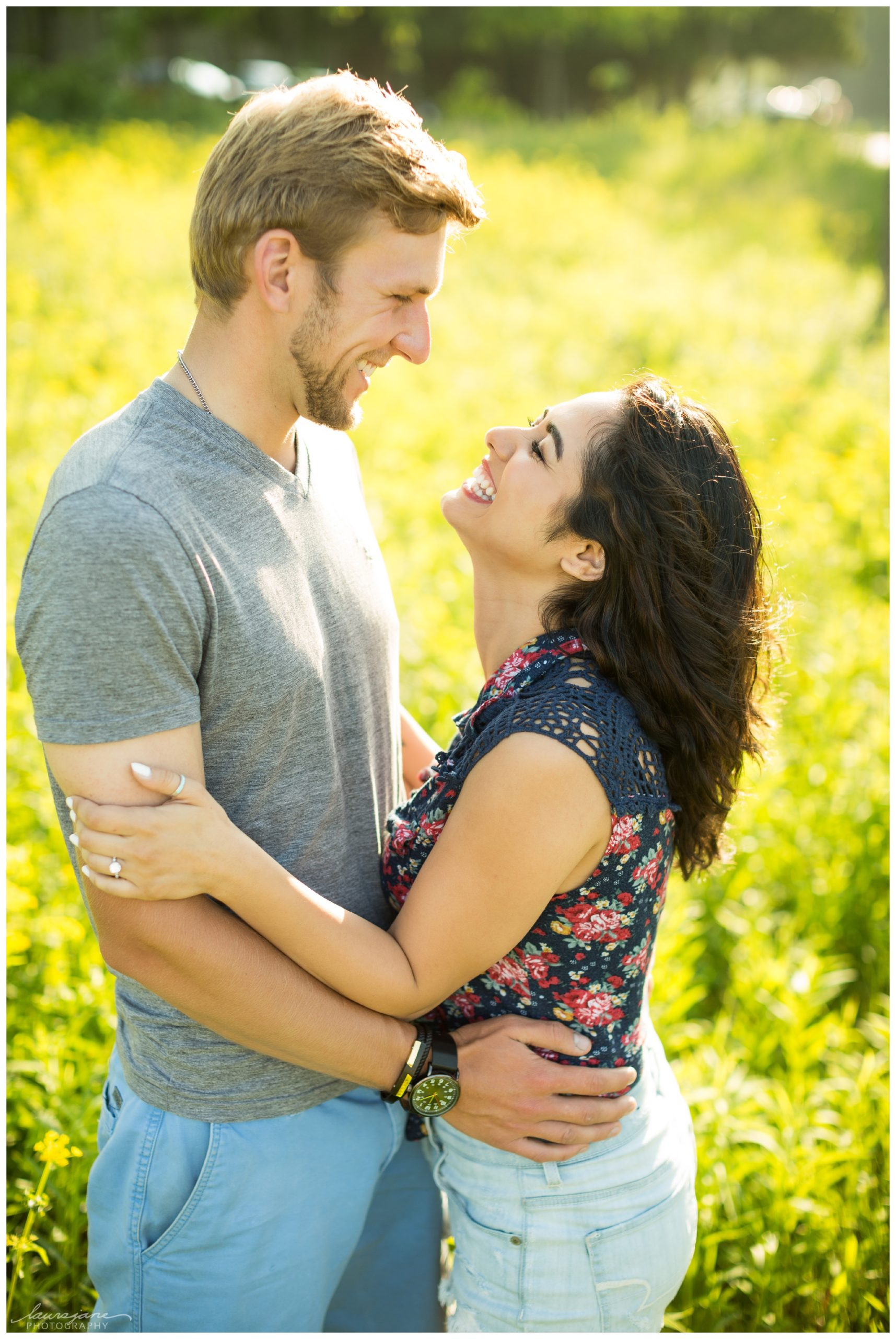 Laughing engagement pictures at Waukesha park