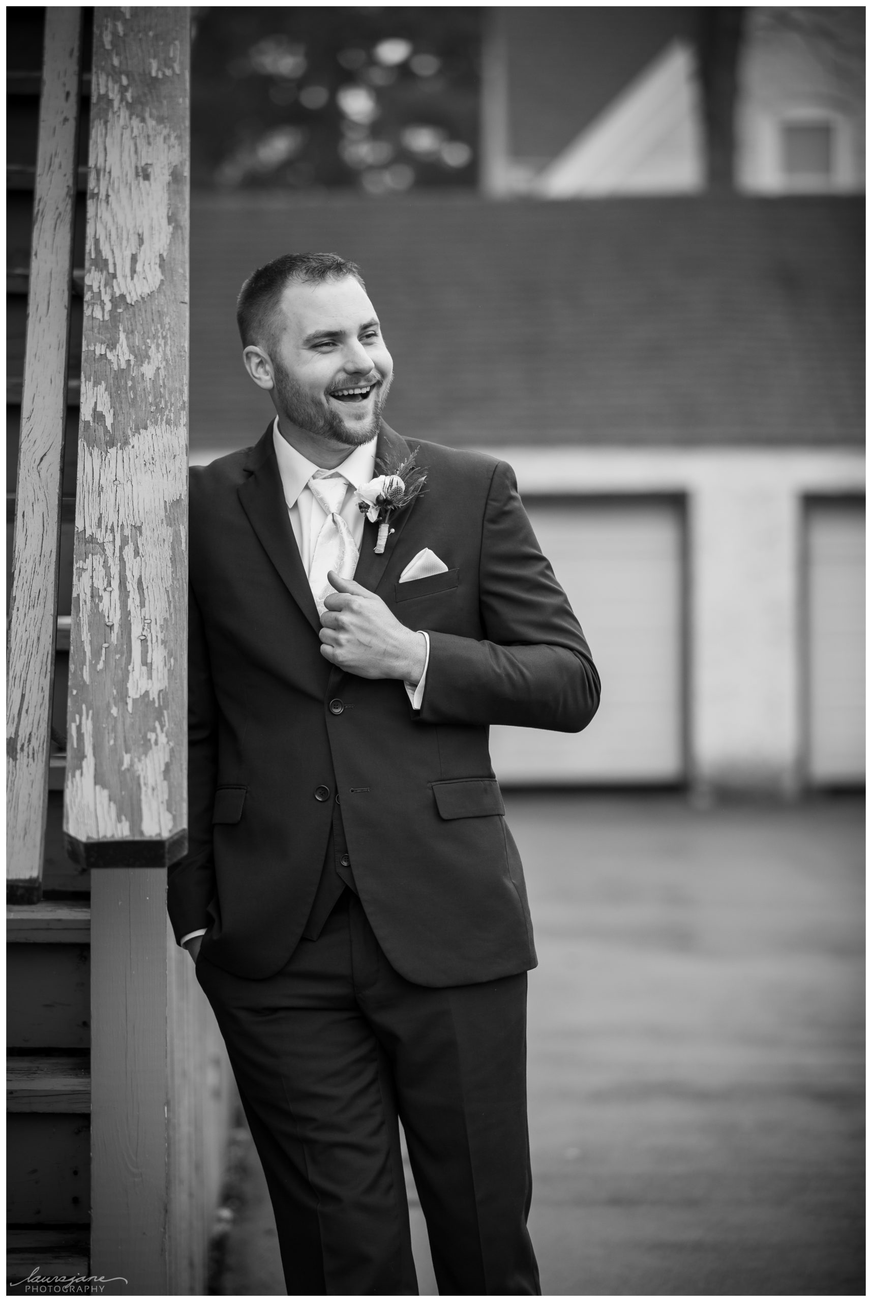 Candid Groom Portrait Downtown Rochester WI